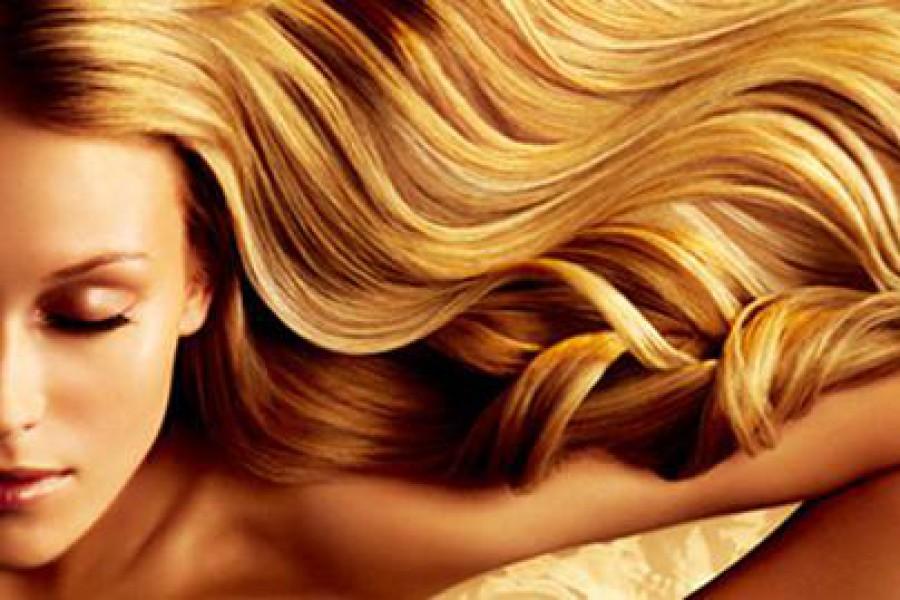 Capelli e sole: rimedi per la protezione dei capelli al sole